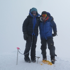 Nina H. on the summit of Denali 2018 wearing Forty Below Fresh Tracks overboots.