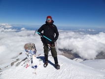 Ben S. on top of Mt. Elbrus wearing 40 Below K2 Superlight overboots